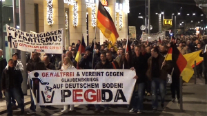 "PEGIDA on a Monday ""evening walk"" in Dresden, November 10, 2014. (Image source: Filmproduktionen video screenshot)"