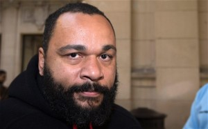 French comedian Dieudonné Mbala to stand trial for allegedly condoning terrorism via Facebook. (Photo: The Telegraph UK)